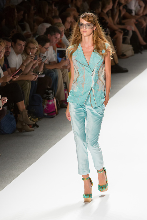 Aqua pants and sleeveless jacket. By Custo Barcelona at the Spring 2013 Fashion Week show in New York.