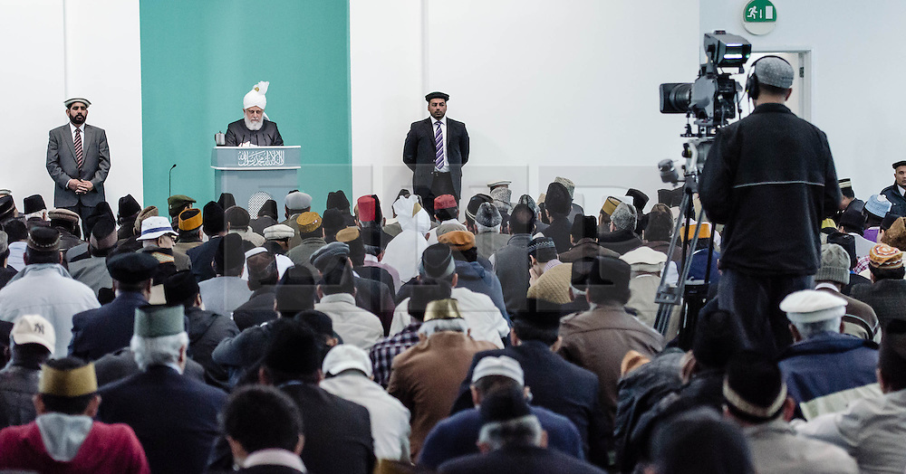 © Licensed to London News Pictures. 21/09/2012. London,UK.  A sermon takes place at the Baitul Futuh Mosque in Morden, London, in the wake of  protests across the Islamic world against the film 'Innocence of Muslims'.  Local spiritual leader His Holiness Hadhrat Mirza Masrror Ahmad gives the sermon.   Photo credit : Richard Isaac/LNP