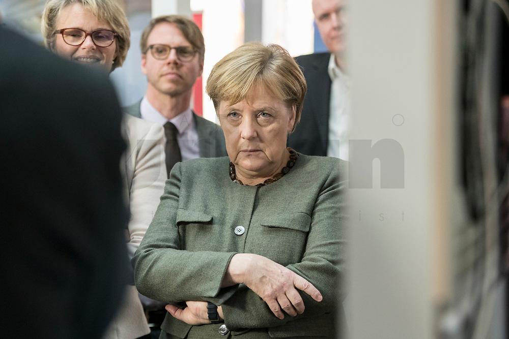 14 NOV 2018, POTSDAM/GERMANY:<br /> Angela Merkel, CDU, Bundeskanzlerin, waehrend einer Praesentation des HPI im Rahmen der Klausurtagung des Bundeskabinetts, Hasso Plattner Institut (HPI), Potsdam-Babelsberg<br /> IMAGE: 20181114-01-084<br /> KEYWORDS; Kabinett, Klausur, Tagung