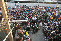 © Licensed to London News Pictures. 17/01/2014. a large crowd gather to have a look at the equipment found inside an abandoned apartment after a suspect threw an explosive device injuring eight people during an anti-government street rally on January 17, 2014 in Bangkok, Thailand. Anti-government protesters launch 'Bangkok Shutdown', blocking major intersections in the heart of the capital, as part of their bid to oust the government of Prime Minister Yingluck Shinawatra ahead of elections scheduled to take place on February 2. Photo credit : Asanka Brendon Ratnayake/LNP