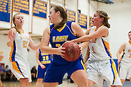 Milton's Taylor Quintin (1) battles for the ball with Lamoille's Tara Barney (23) during the girls basketball game between Lamoille and Milton at Milton High School on Friday night December 18, 2015 in Milton, (BRIAN JENKINS/for the FREE PRESS)