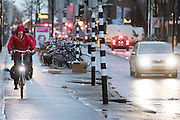 In Utrecht rijden fietsers over de Amsterdamsestraatweg tegen de wind in.<br /> <br /> In Utrecht cyclists are riding against the wind.
