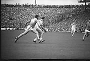 The All Ireland Senior Football Final.1982.19.09.1982.09.19.1982.19th September 1982..The senior final was contested between Offaly and Kerry. Offaly won the title by the narrowest of margins 1.15 to 17 points..An Offaly defender takes control despite the attentions of Liston.