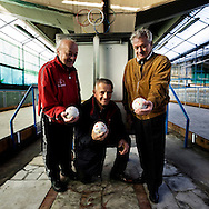 Rome, Olympic Village. Three men pose at the Olympic Village bowling club that opened a few months after the closing ceremony of the Games. In the middle of Parioli and Flaminio smart districts in Rome, along the ancient Via Flaminia one of the first Olympic villages was built for the 17th Olympic Games. After the end of the games a new residential district was created after assigning the flats to beneficiaries. The last five years the village's population is changing. The construction of the Auditorium next to the village increased the request for apartments mostly from Rome's upper class, architects, engineers, teacher, lecturers are buying more and more apartments in order to renovate them and live there with their families due to the oversize facilities, parking space and green areas for their children to play. Twenty years ago a flat at the Olympic village cost approximately 18,000 euros now its price has rise to 400-500,000 euros.