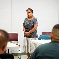 Commissioner Genevieve Jackson draws from personal experience to speak to the men in the substance abuse treatment program, Wednesday, July 18 at the McKinley Adult Dentention Center.