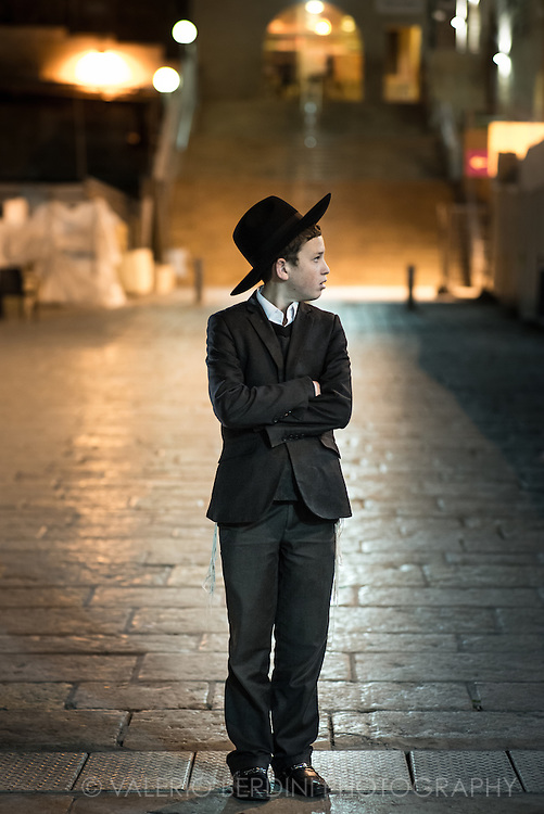 Yeshivish (the young boy studing the torah in yeshiva) wear modern clothing and match (up to a point) the elegant spirit of European fashion. They wear dark pants, a white buttoned shirt, short suit, tie and a black hat. Western Wall plaza, Jerusalem.