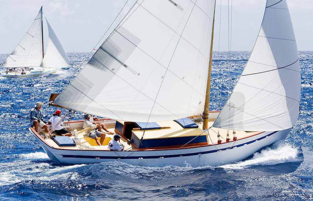 Two unidentified Carriacou sloops racing at the 2008 Antigua Classic Yacht Regatta . This race is one of the worlds most prestigious traditional yacht races. It takes place annually off the coast of Antigua in the British West Indies.