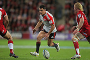 Dan Carter chips ahead , on the way to his try during the Super Rugby Final at Suncorp Stadium in Brisbane,  July 9, 2011.  Photo: Patrick Hamilton/Photosport