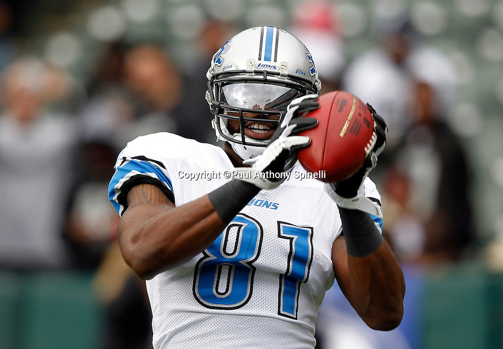 Detroit Lions wide receiver Calvin Johnson (81) catches a pregame pass during the NFL week 15 football game against the Oakland Raiders on Sunday, December 18, 2011 in Oakland, California. The Lions won the game 28-27. ©Paul Anthony Spinelli