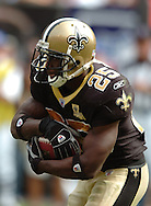 MORNING JOURNAL/DAVID RICHARD.New Orleans Saints running back Reggie Bush looks for running room against the Browns.