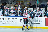 KELOWNA, CANADA - FEBRUARY 20: Erik Gardiner #12 of the Kelowna Rockets celebrates a second period goal at the bench against the Prince George Cougars on February 20, 2018 at Prospera Place in Kelowna, British Columbia, Canada.  (Photo by Marissa Baecker/Shoot the Breeze)  *** Local Caption ***