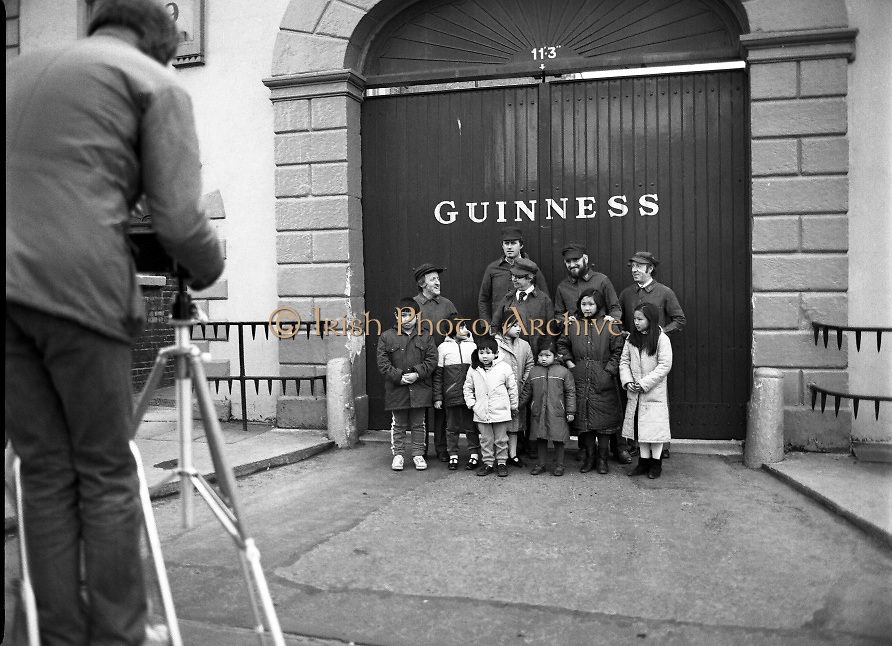 Chieftains at Guinness Brewery, Dublin meet with Chinese children on tour. ..1983-02-21.21st February 1983.21/02/1983.02-21-83 ..Pictured at Guinness Brewery, St James's Gate, Dublin..Chieftains stand outside the Guiinness Brewery