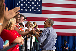 President Barack Obama shakes hands following remarks at the Milwaukee Laborfest at Henry Maier Festival Park in Milwaukee, Wis. on Labor Day, Sept. 1, 2014. (Official White House Photo by Pete Souza)<br /> <br /> This official White House photograph is being made available only for publication by news organizations and/or for personal use printing by the subject(s) of the photograph. The photograph may not be manipulated in any way and may not be used in commercial or political materials, advertisements, emails, products, promotions that in any way suggests approval or endorsement of the President, the First Family, or the White House.