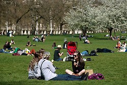 © Licensed to London News Pictures. 01/05/2013. London, UK. People enjoy the May sunshine in St. James Park on May 1, 2013 in London. After the coldest start to spring for more than 50 years, forecasters say the sunshine and warm weather has finally arrived in London.Photo credit : Peter Kollanyi/LNP
