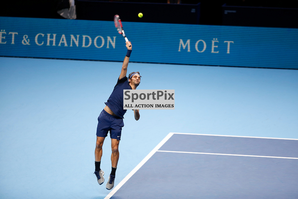 Roger Federer serves during a semi-final match between Roger Federer and Stan Wawrinka at the ATP World Tour Finals 2015 at the O2 Arena, London.  on November 21, 2015 in London, England. (Credit: SAM TODD | SportPix.org.uk)