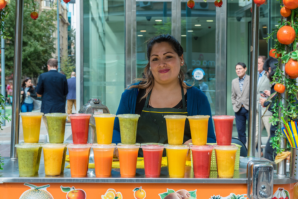 Santiago, Chile--April 6, 2018. A merchant selling fruit juices from her cart  in Santiago, Chile. Editorial use only.