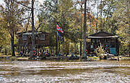 Fishing camp with confederate flag on the the Pearl River in St. Tammany Parish, Louisiana, lined with Cypress and Tupelo trees.