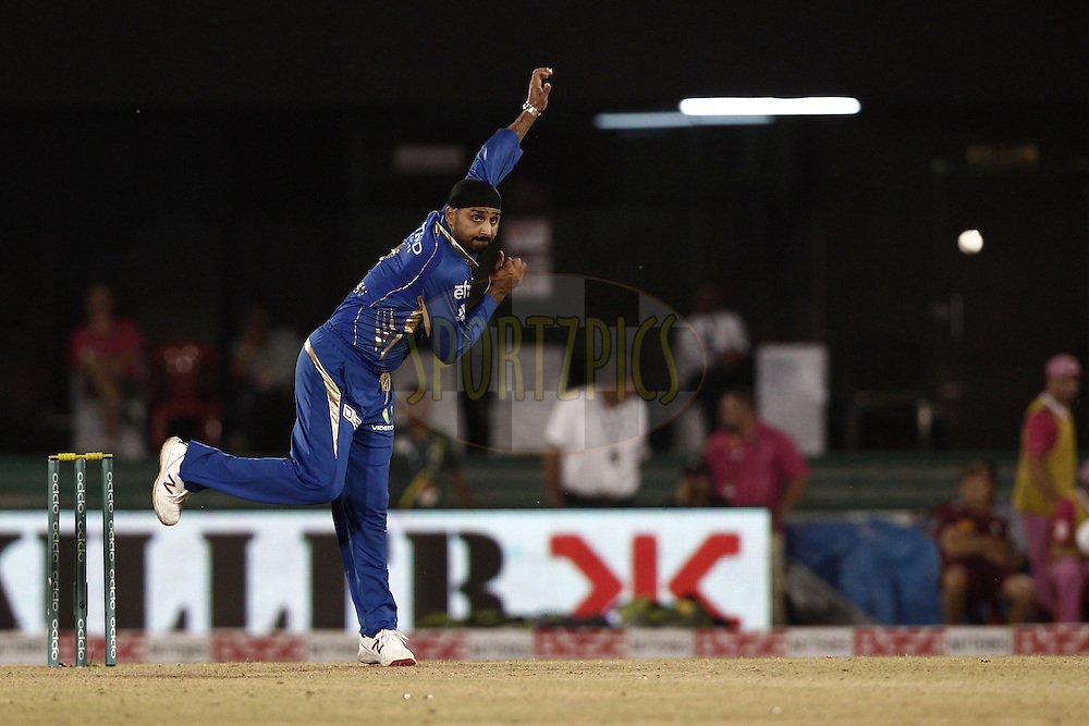 Harbhajan Singh of the Mumbai Indians during the qualifier 6 match of the Oppo Champions League Twenty20 between the Mumbai Indians and the Northern Knights held at the Chhattisgarh International Cricket Stadium, Raipur, India on the 16th September 2014<br /> <br /> Photo by:  Deepak Malik / Sportzpics/ CLT20<br /> <br /> <br /> Image use is subject to the terms and conditions as laid out by the BCCI/ CLT20.  The terms and conditions can be downloaded here:<br /> <br /> http://sportzpics.photoshelter.com/gallery/CLT20-Image-Terms-and-Conditions-2014/G0000IfNJn535VPU/C0000QhhKadWcjYs