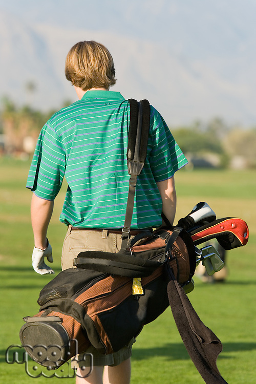 Golfer Walking Down Fairway Carrying Club Bag