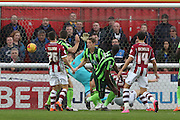 Tom Elliott of AFC Wimbledon (centre) puts the Dons ahead during the Sky Bet League 2 match between Exeter City and AFC Wimbledon at St James' Park, Exeter, England on 28 December 2015. Photo by Stuart Butcher.