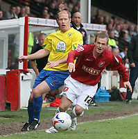Photo: Mark Stephenson.<br />Walsall v Hereford United. Coca Cola League 2. 09/04/2007. Walsall's Dean Keates skips past Hereford's Simon Travis