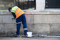 © Licensed to London News Pictures. 22/10/2019. LONDON, UK.  A workman cleans graffiti which shows the words STOP BORIS from a wall in Whitehall opposite Downing Street.  MPs are due to vote in the House of Commons on whether to support the Prime Minister's European Union (Withdrawal Agreement) Bill.  If approved, MPs will then be asked to support a three-day schedule in which to consider the relevant legislation, but critics have said that it is not enough time to analyze the 110 page document in detail.  Photo credit: Stephen Chung/LNP