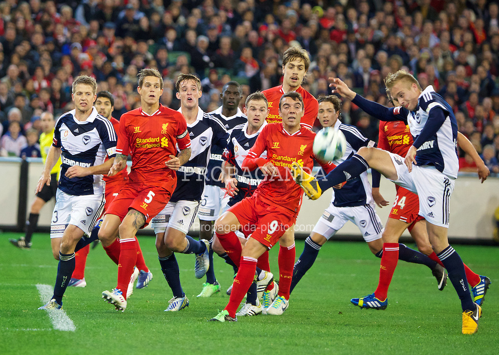MELBOURNE, AUSTRALIA - Wednesday, July 24, 2013: Liverpool's Daniel Agger, Iago Aspas and Sebastian Coates in action against Melbourne Victory during a preseason friendly match at the Melbourne Cricket Ground. (Pic by David Rawcliffe/Propaganda)