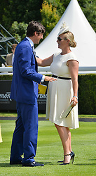 JAKE WARREN and ZARA TINDALL at the 2014 Glorious Goodwood Racing Festival at Goodwood racecourse, West Sussex on 31st July 2014.
