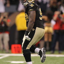 16 January 2010:  New Orleans Saints defensive tackle Sedrick Ellis (98) celebrates on the field during a 45-14 win by the New Orleans Saints over the Arizona Cardinals in a 2010 NFC Divisional Playoff game at the Louisiana Superdome in New Orleans, Louisiana.