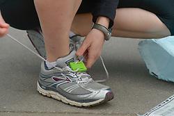 13.04.2014, Wien, AUT, Vienna City Marathon 2014, im Bild das Binden des Chips an den Laufschuh, Feature // bindiung the chip onto the show, feature, during Vienna City Marathon 2014, Vienna, Austria on 2014/04/13. EXPA Pictures © 2014, PhotoCredit: EXPA/ Gerald Dvorak