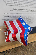 """East Meadow, New York, U.S. 11th September 2013. A patriotic red white and blue balloon has messages written on it to William V. Steckman (Pop-Pop) of West Hempstead, who worked for NBC in the North Tower of Twin Towers, and died 9/11 2001. The Global War on Terror """"Wall of Remembrance"""" a traveling memorial on display in New York for the first time, was at Eisenhower Park on the 12th Anniversary of the terrorist attacks of 9/11. The unique 94 feet long by 6 feet high wall has, on one side, almost 11,000 names of those lost on September 11, 2001, along with heroes and veterans who lost their lives defending freedom of Americans over past 30 years. On the wall's other side is a timeline, with photos, covering 1983 to present day."""