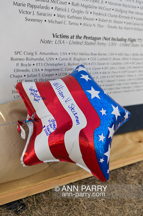 "East Meadow, New York, U.S. 11th September 2013. A patriotic red white and blue balloon has messages written on it to William V. Steckman (Pop-Pop) of West Hempstead, who worked for NBC in the North Tower of Twin Towers, and died 9/11 2001. The Global War on Terror ""Wall of Remembrance"" a traveling memorial on display in New York for the first time, was at Eisenhower Park on the 12th Anniversary of the terrorist attacks of 9/11. The unique 94 feet long by 6 feet high wall has, on one side, almost 11,000 names of those lost on September 11, 2001, along with heroes and veterans who lost their lives defending freedom of Americans over past 30 years. On the wall's other side is a timeline, with photos, covering 1983 to present day."