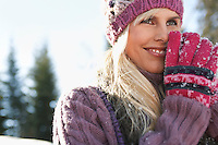 Woman wearing winter clothing smiling portrait