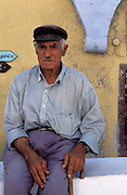 GREECE.The Cyclades: Santorini (Thira) .Local man in Ia.