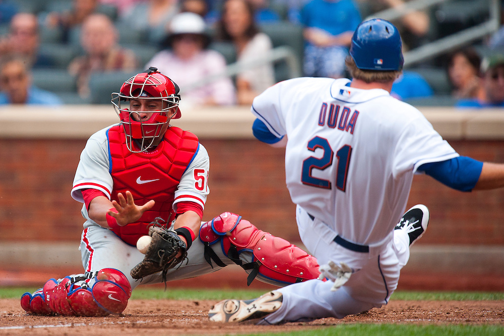 NEW YORK - JULY 16: Lucas Duda #21 of the New York Mets slides into home plate as Carlos Ruiz #51 of the Philadelphia Phillies attempts to make a tag during the game against the Philadelphia Phillies at Citi Field on July 16, 2011 in the Queens borough of Manhattan. (Photo by Rob Tringali) *** Local Caption *** Lucas Duda;Carlos Ruiz