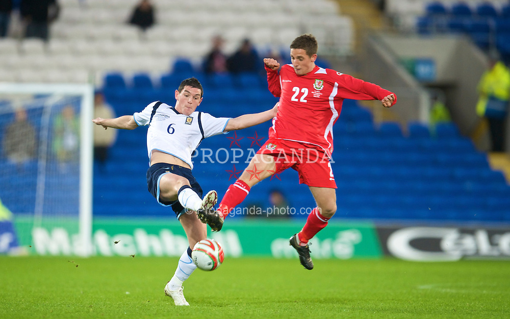CARDIFF, WALES - Saturday, November 14, 2009: Wales' Joe Allen and Scotland's Graham Dorrans during the international friendly match at the Cardiff City Stadium. (Pic by David Rawcliffe/Propaganda)