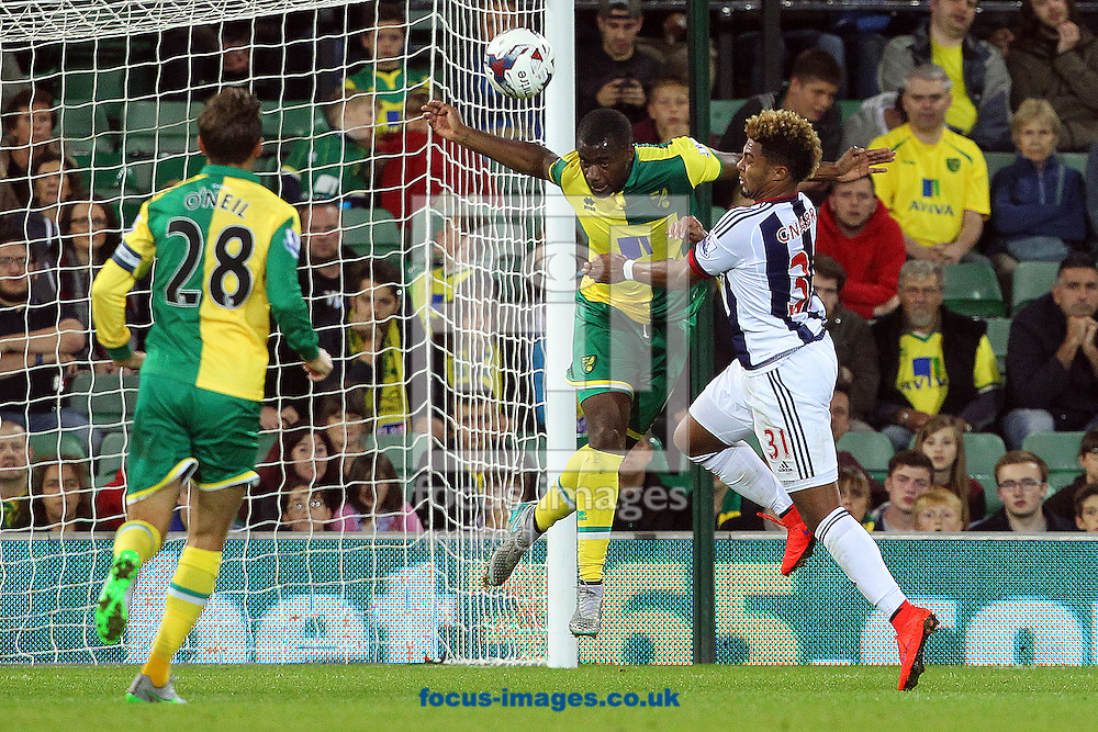 Sebastien Bassong of Norwich heads clear during the Capital One Cup match at Carrow Road, Norwich<br /> Picture by Paul Chesterton/Focus Images Ltd +44 7904 640267<br /> 23/09/2015