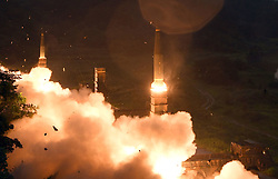 29 July 2017 - South Korea : (In this photo handout provided by South Korea Defense Ministry) South Korea's Hyunmoo II Missile system fires a missile during the combined military exercise between the U.S. and South Korea against North Korea at an undisclosed location in South Korea on July 29, 2017. North Korean leader Kim Jong Un said Saturday the second flight test of an intercontinental ballistic missile demonstrated his country can hit the U.S. mainland, hours after the launch left analysts concluding that a wide swath of the United States, including Los Angeles and Chicago, is now in range of North Korean weapons. Photo Credit: South Korea Defense Ministry/Handout *** Please Use Credit from Credit Field ***
