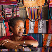 Piedade da Cruz in her shop in Dili. She sell hand made traditional craft works, mainly textiles. She has her own shop now in the popular Tais district where many tourist shop. She used to sell in the street but with the help and support of Alola she has now manged to expand her business and set up shop. Fundasaun Alola is a not for profit non government organization operating in Timor Leste to improve the lives of women and children. Founded in 2001 by the then First Lady, Ms Kirsty Sword Gusmao, the organization seeks to nurture women leaders and advocate for the rights of women.