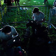 July 13, 2013 - New York, NY : Wire service photographers including Reuters' Andrew Kelly, top right, work on transmitting their pictures following <br /> The New York Philharmonic's performance -- with Mariah Carey -- in the free MLB All-Star Charity Concert to benefit Hurricane Sandy victims, in Central Park's great lawn on July 13, 2013.  <br /> CREDIT: Karsten Moran for The New York Times