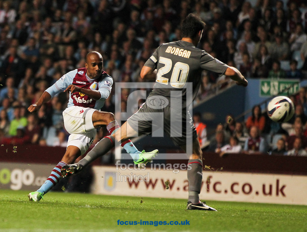 Picture by Tom Smith/Focus Images Ltd 07545141164<br /> 28/08/2013<br /> Fabian Delph (left) of Aston Villa scores his sides third goal during the Capital One Cup match at Villa Park, Birmingham.