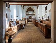 Village parish church Parham, Suffolk, England, UK view of nave to east window