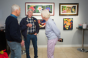 Dave Beto, center, talks with John Zink, left, and Carol Zink in the art gallery room at Hoson House on Sunday, December 4, 2016 in Tustin, California.