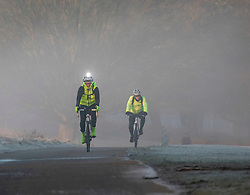 © Licensed to London News Pictures. 07/02/2020. London, UK. Calm before the storm. Cyclists commute to work as the sun rises through the frost and mist in Richmond Park this morning as weather experts predict stormy weather with high winds and heavy rain for the weekend. Photo credit: Alex Lentati/LNP