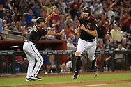 Aug 12, 2017; Phoenix, AZ, USA; Arizona Diamondbacks infielder Adam Rosales (9) rounds third base to score against the Chicago Cubs in the sixth inning at Chase Field. Mandatory Credit: Jennifer Stewart-USA TODAY Sports