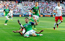 Conor McLaughlin of Northern Ireland denies Bartosz Kapustka of Poland with a last ditch tackle  - Mandatory by-line: Joe Meredith/JMP - 12/06/2016 - FOOTBALL - Stade de Nice - Nice, France - Poland v Northern Ireland - UEFA European Championship Group C