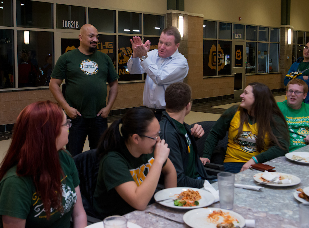 December 5, 2015 - Fairfax, VA - A day in the life of &quot;Doc Nix,&quot; aka Dr. Michael Nickens, the Director of the Athletic Bands for George Mason University. Here basketball coach Dave Paulsen thanks the band for their support after the game at Brion's Grille.<br /> <br /> Photo by Susana Raab