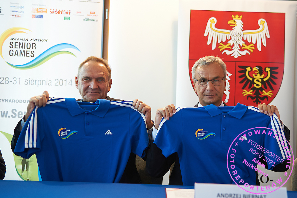 (L) Andrzej Krasnicki president of Polish Olympic Committee and (R) Andrzej Biernat Minister of Sport Departament hold official t-shirts of Senior Games Warmia Mazury 2014 during press conference at Polish Olympic Committee in Warsaw, Poland.<br /> <br /> Poland, Warsaw, August 27, 2014<br /> <br /> Picture also available in RAW (NEF) or TIFF format on special request.<br /> <br /> For editorial use only. Any commercial or promotional use requires permission.<br /> <br /> Photo by &copy; Adam Nurkiewicz / Mediasport