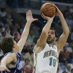 New Orleans Hornets forward Peja Stojakovic #16 shoots over Utah Jazz forward Kyle Korver #26 in the second quarter of their NBA game on April 8, 2008 at the New Orleans Arena in New Orleans, Louisiana.