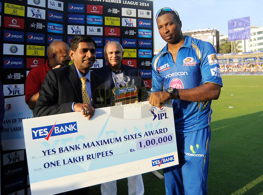 Kieron Pollard of the Mumbai Indians receives the Yes bank Maximum sixes award during the presentation after match 16 of the Pepsi Indian Premier League 2014 between the Delhi Daredevils and the Mumbai Indians held at the Sharjah Cricket Stadium, Sharjah, United Arab Emirates on the 27th April 2014<br /> <br /> Photo by Pal Pillai / IPL / SPORTZPICS